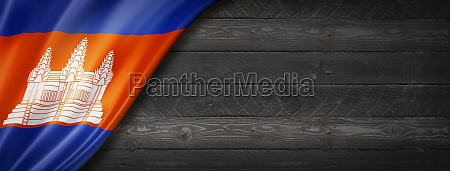 cambodian flag on black wood wall