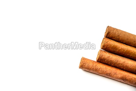 group of brown cuban cigars isolated