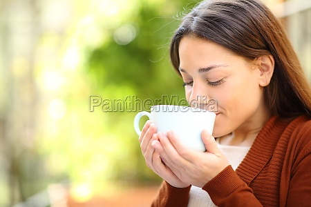 relaxed woman drinking coffee in a