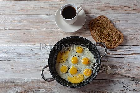fried quail eggs in a pan