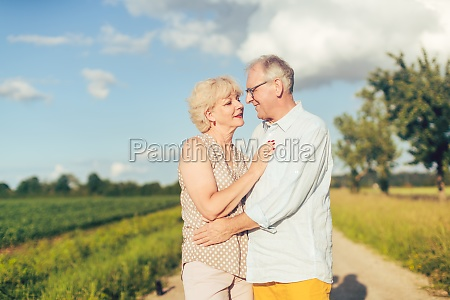 senior couple embracing each other in