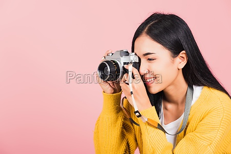 woman smiling photographer taking a picture
