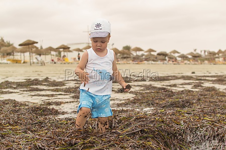 kid on the beach near the