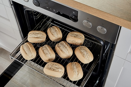 buns in modern oven at home