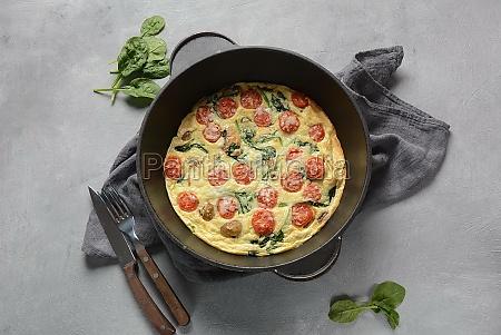 frittata made of eggs mushrooms cherry