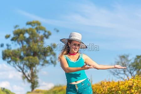 brazilian woman dressed in blue showing