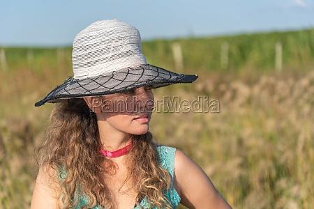 blonde woman wearing a hat in