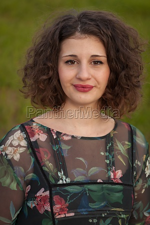 happy curvy girl with curly hair