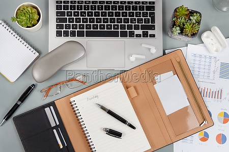 laptop cell phone and agenda on