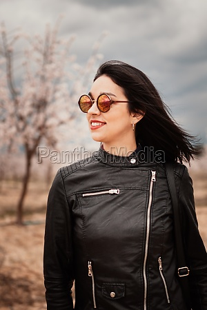 brunette woman with leather jacket surrounded