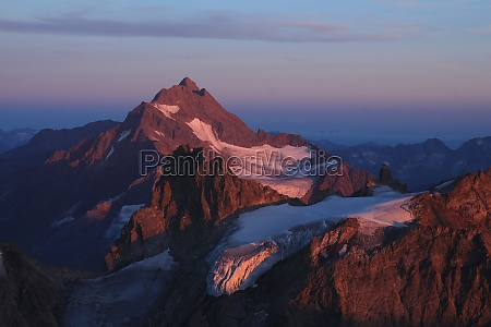 high mountain in purple evening light