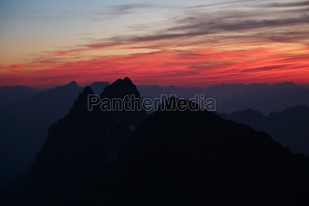 colorful sky over high mountains in