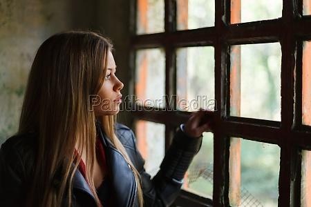 pensive blonde woman next to a
