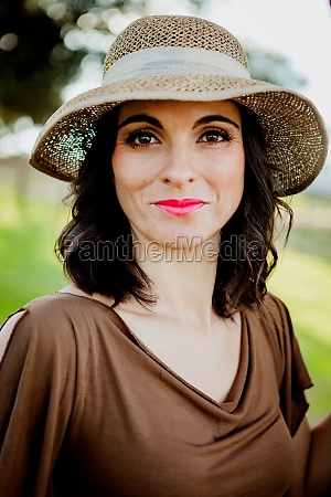 stylish young woman with straw hat