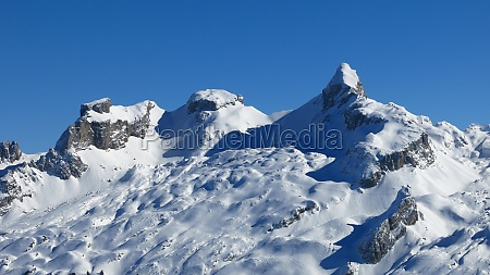 snow covered mountains chaiserstock and chronenstock