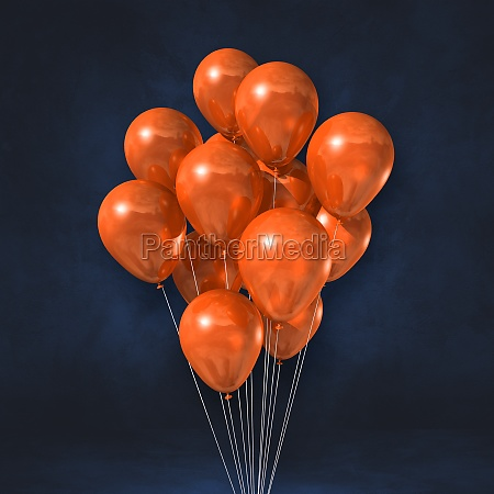 orange balloons bunch on a black