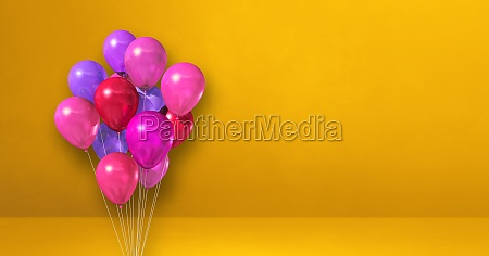 pink balloons bunch on a yellow