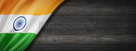 indian flag on black wood wall