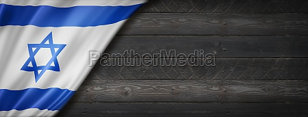 israeli flag on black wood wall