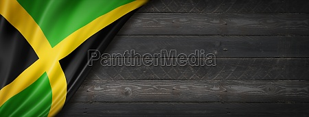 jamaican flag on black wood wall