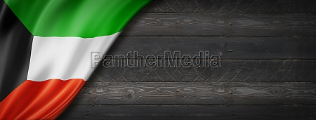 kuwaiti flag on black wood wall