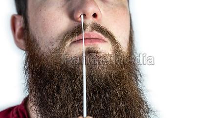 covid 19 nasal swab test taking