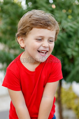 happy child with red t shirt