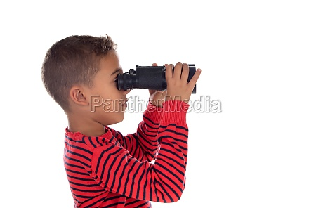 latin child looking through a binoculars