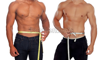two male bodies with tape measure