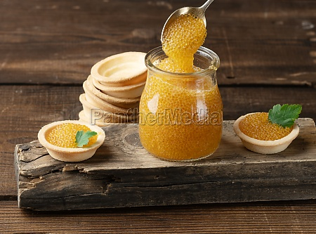 salted pike caviar in a glass