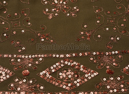 dark green fabric with sequin embroidery