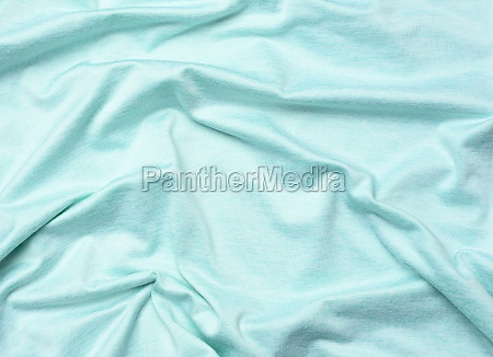 wrinkled blue cotton fabric for sewing