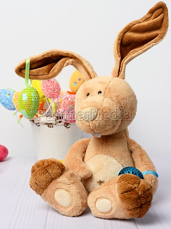 toy bunny sitting on a white