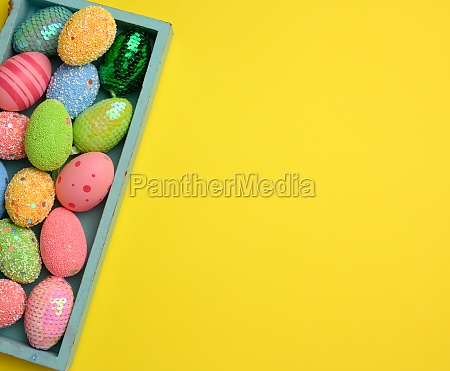 decorative easter eggs on a yellow