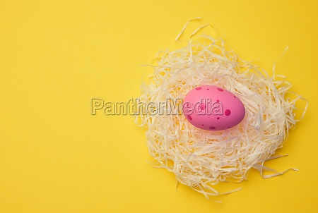 decorative easter egg in a nest