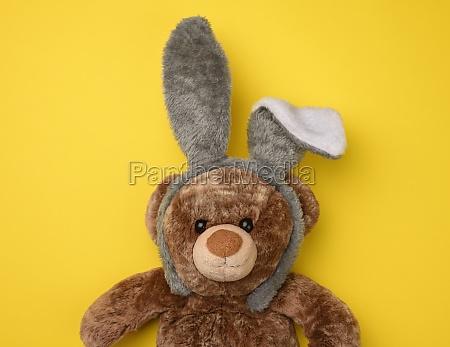 cute brown teddy bear wearing a