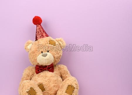 teddy beige bear in a red