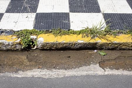 old sidewalk erosion water flowing