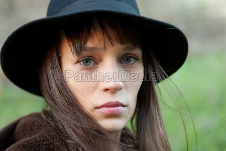 sad woman with black hat