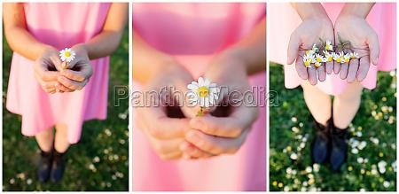 girl in pink dress picking up