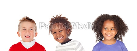 three different children looking at camera