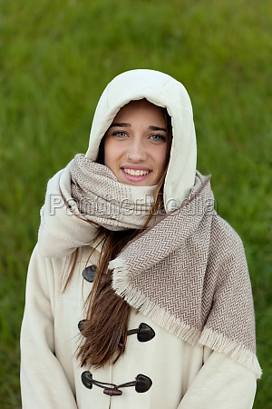 sheltered girl with hood and scarf