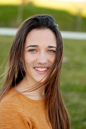 outdoor portrait of beautiful happy teenager