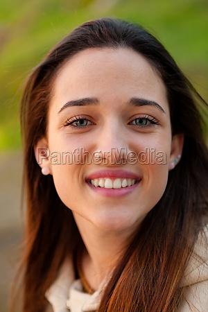smiling teen girl outside