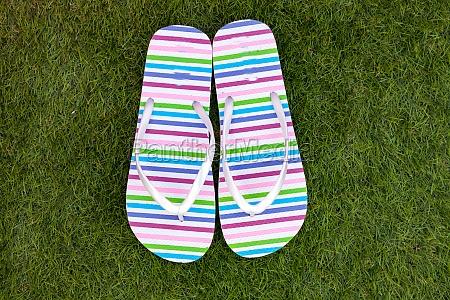 flip flops on the green grass