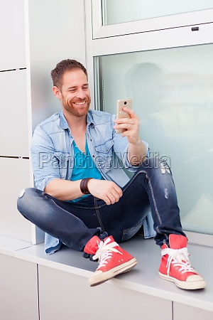cool guy with a mobile during