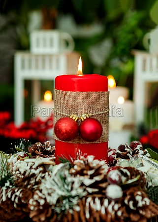 candle for christmas in red