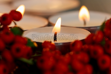christmas candles with berries