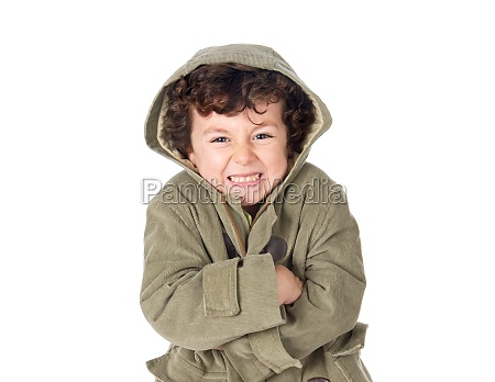 very cold child wearing hooded coat