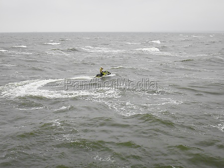 jet skiing off the coast of